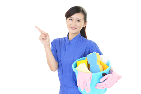 cleaning service: A smiling woman with a bucket Stock Photo