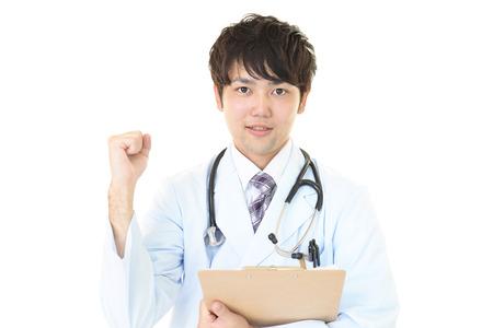 笑みを浮かべてアジア医師 写真素材