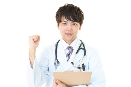 happy doctor: Smiling Asian medical doctor Stock Photo