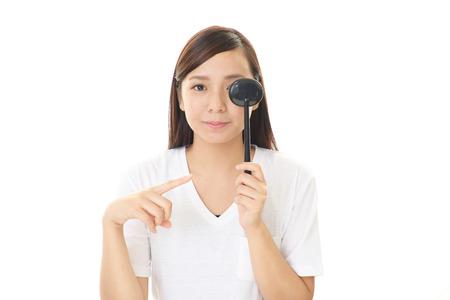 eye test: Woman taking an eye test
