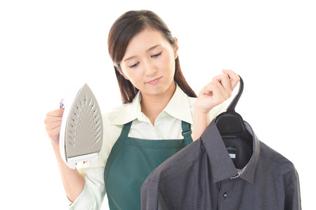 ironing: Young woman ironing clothes