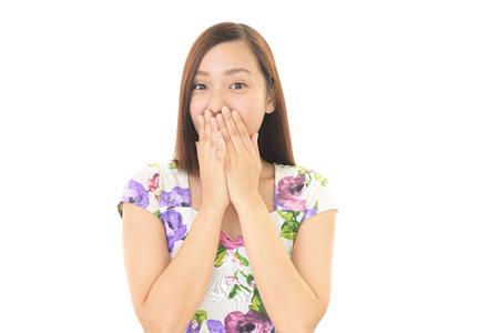 surprises: Surprised Asian woman