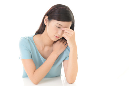 Tired Asian woman