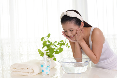 facial expression: Woman washing her face Stock Photo