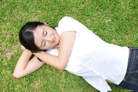 stretch out: Woman lie on the grass Stock Photo