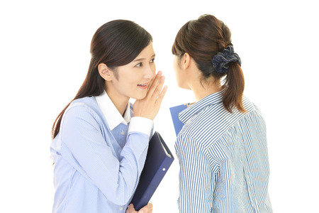 secret: Women gossip Stock Photo