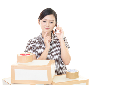 moving box: Woman with moving box in her house