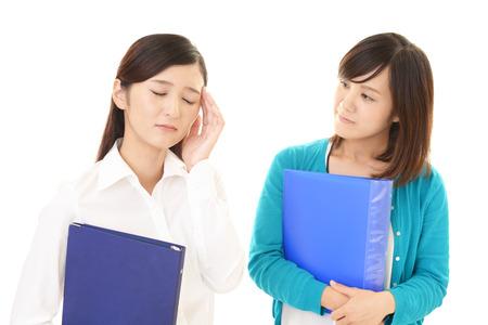 asian business women: Tired Asian business women Stock Photo