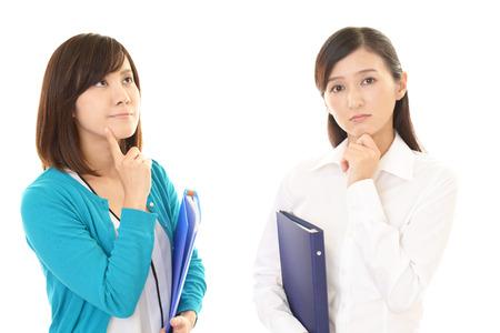 asian business women: Dissatisfied Asian business women Stock Photo