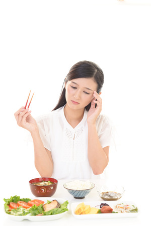 lack: Woman has no appetite Stock Photo