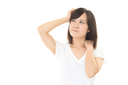 dolor hombro: Woman who has a shoulder pain Foto de archivo