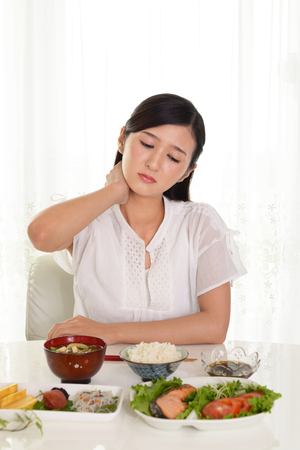 overeating: Woman has no appetite Stock Photo