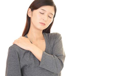 Woman who has a shoulder pain Standard-Bild