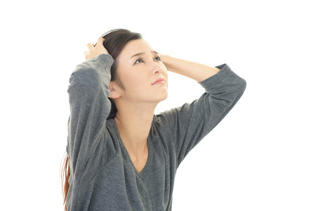 unrest: Woman who is worried Stock Photo