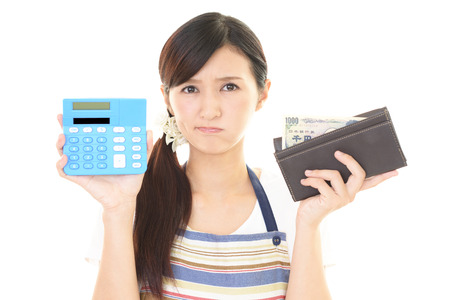 money problems: Woman who is worried Stock Photo