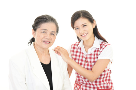 Smiling old woman and young lady Stock Photo