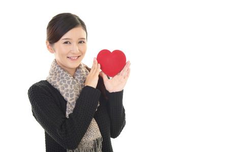 women s health: Woman with Heart Stock Photo