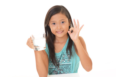 The girl drinking a glass of water