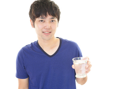 Healthy hair: Man drinking water.