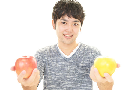 calibrate: Asian man with apples Stock Photo
