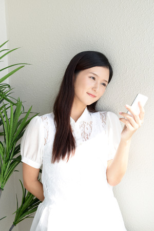 woman on phone: Woman using a smart phone