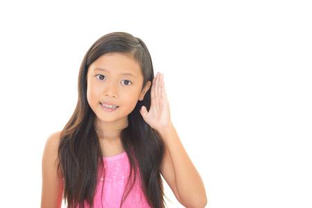 carefully: Asian girl listen carefully Stock Photo
