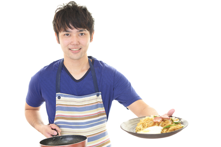 asian cook: A man cooking healthy food Stock Photo