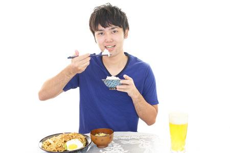 asian man face: Asian man having dinner Stock Photo