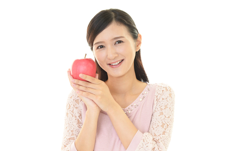 girl  care: Woman smiling with fruit Stock Photo