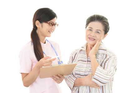 nursing assistant: A friendly nurse takes care of an elderly woman Stock Photo
