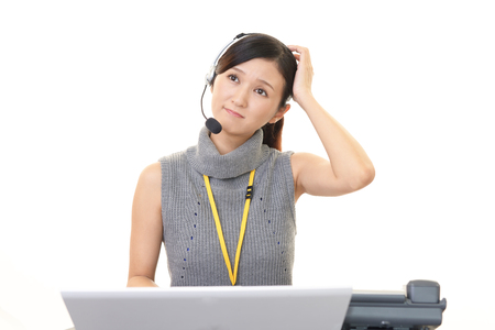 dissatisfaction: Operator with an uneasy look Stock Photo