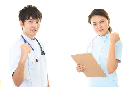 medical treatment: Smiling doctor and nurse