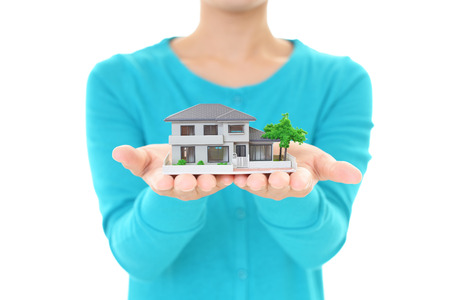 Woman with a house model Stockfoto
