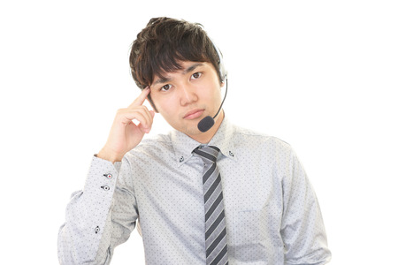 service man: Tired telephone operator Stock Photo