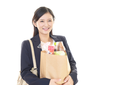 health food store: Smiling young woman