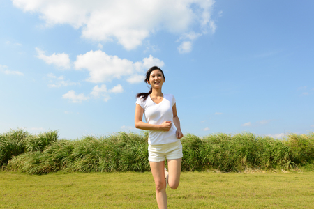 japanese people: Young woman doing exercise Stock Photo