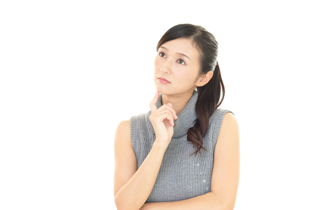 tired face: Woman who is worried Stock Photo