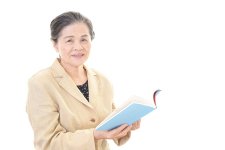 frailty: Old woman reading a book
