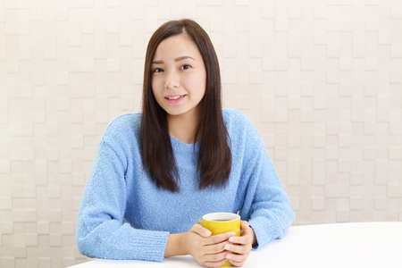daily room: Woman who enjoys the coffee break