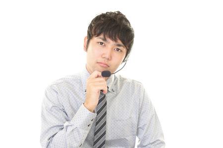 tired: Tired telephone operator Stock Photo