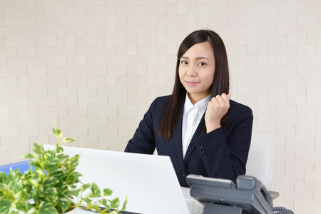 business challenge: The female office worker who poses happily Stock Photo