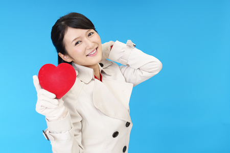 emotional couple: Woman with Heart Stock Photo