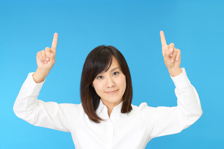 suggestions: Young business woman pointing upward