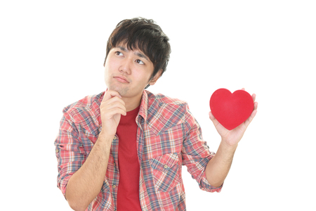 heartbreak issues: Depressed Asian man Stock Photo