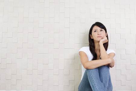 sitting pretty: Woman in depression Stock Photo