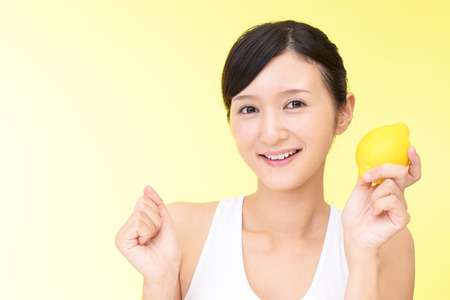 girl  care: Woman smiling with lemon