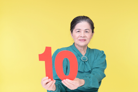 frailty: Old woman with a number Stock Photo