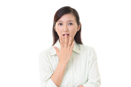 face work: Surprised Asian woman