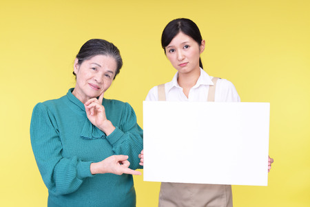 Depressed Asian old woman and young lady Stock Photo