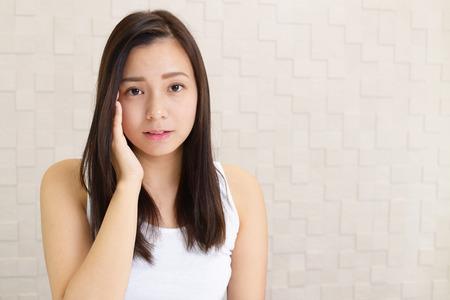 Depressief Aziatische vrouw.